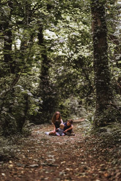 siblings sat together on the forest floor