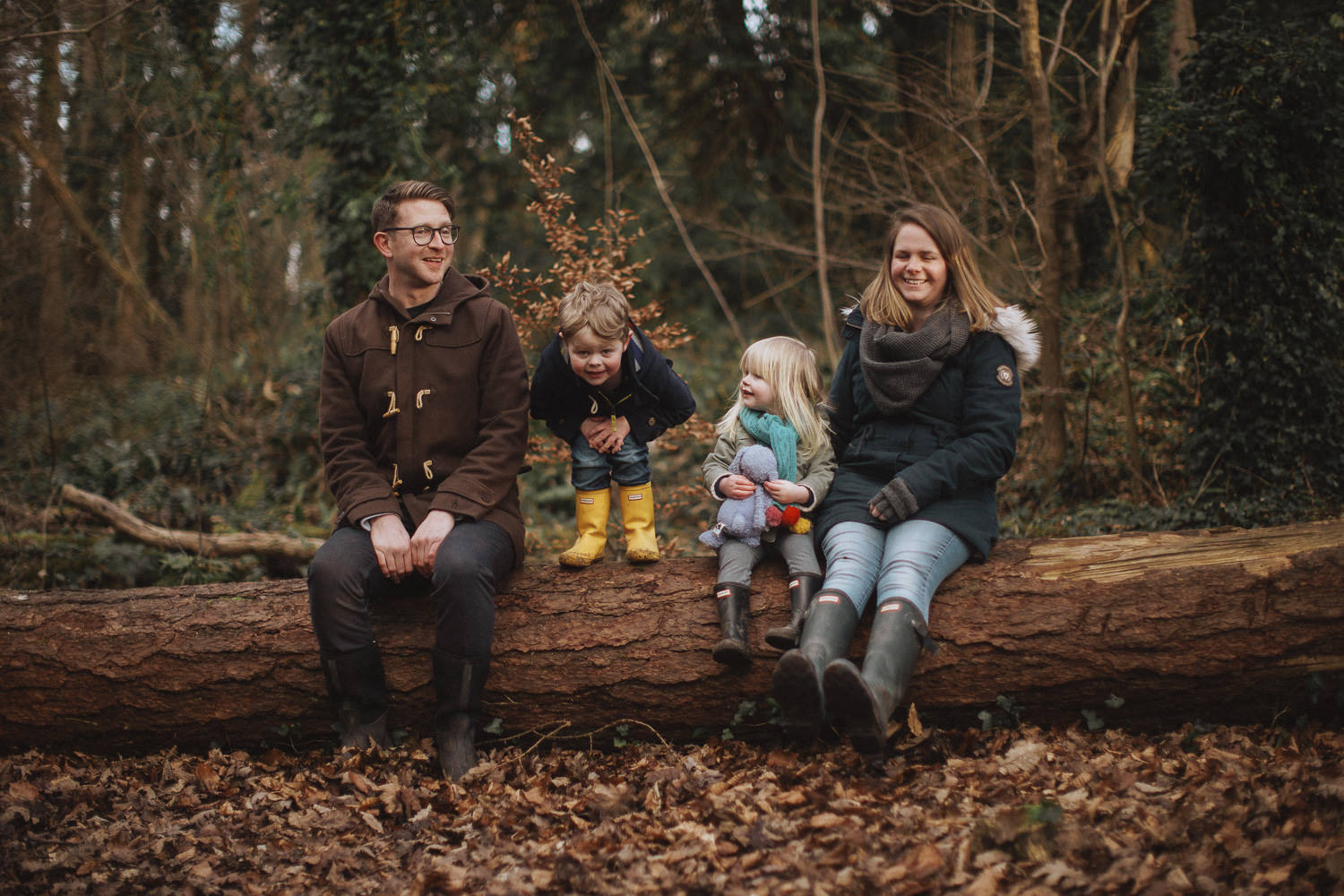 fun family photo in the woods