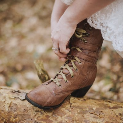 bride's boots in the forest