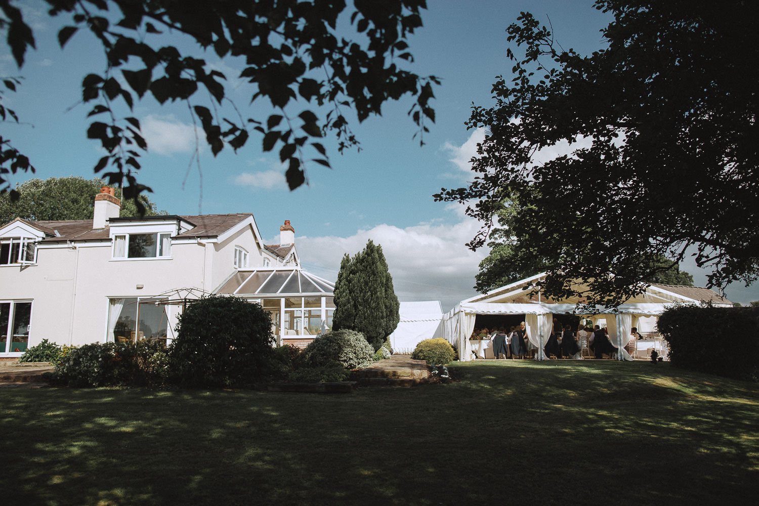 a house and a marquee next to it