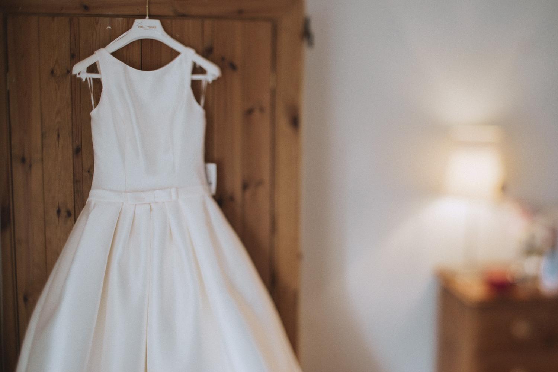 A wedding dress hung up