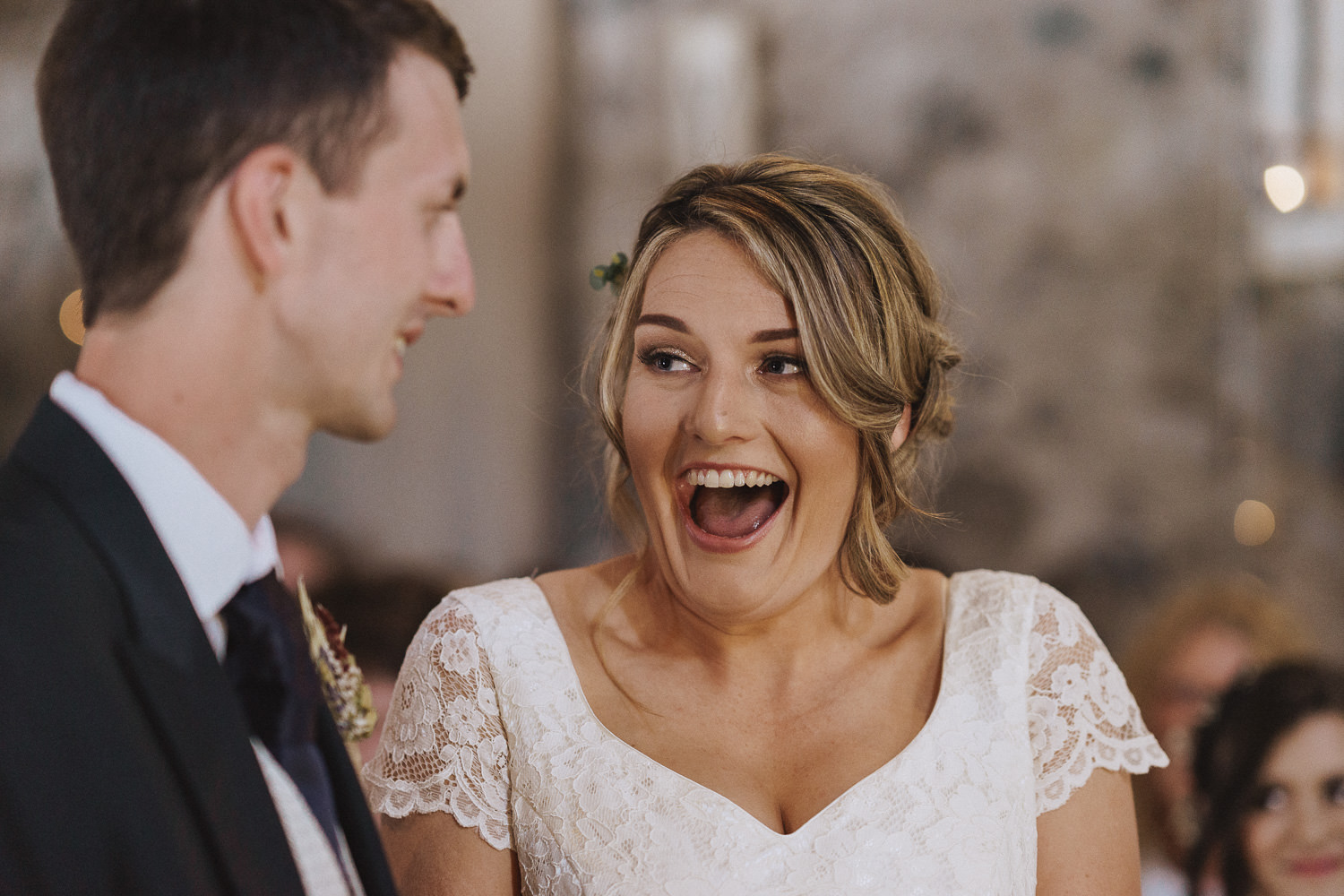 Bride with the biggest smile on her face during her ceremony
