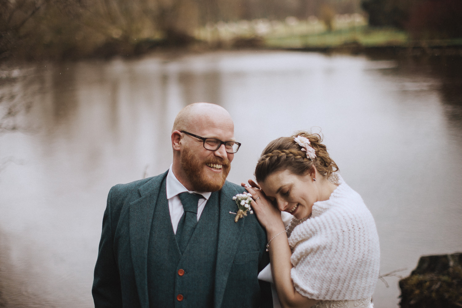 Bride and groom laughing together in the lake district