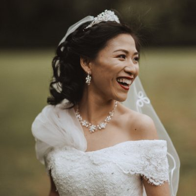 chinese bride laughing on her wedding day