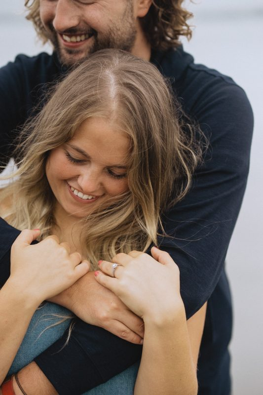 smiling couple in a hug