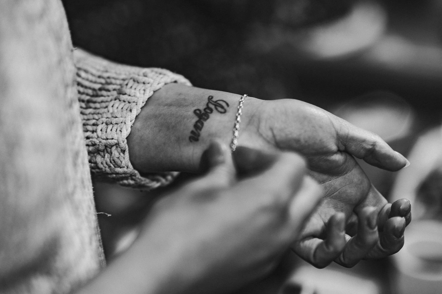 a bride with her son's name tattooed on her wrist