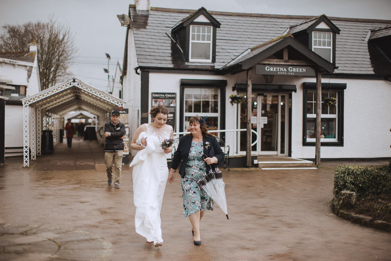 bride and her mum walking to her wedding at the famous blacksmith in gretna green