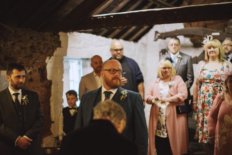 groom waits for his bride at gretna green