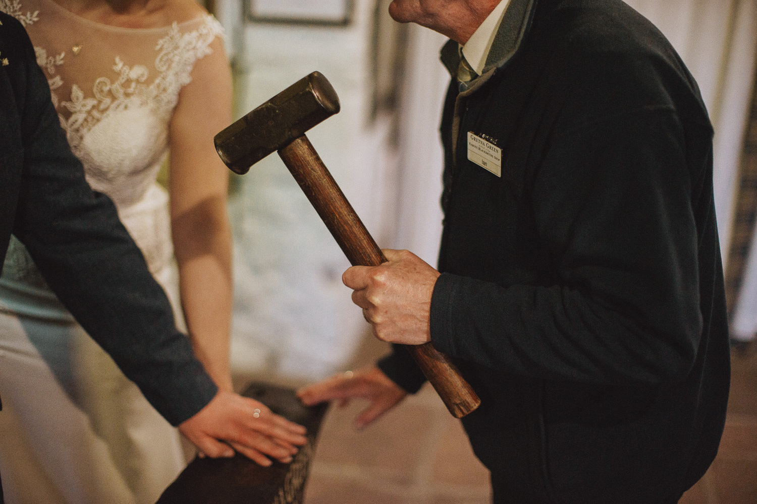 bride and groom during a blacksmith tradition at gretna green