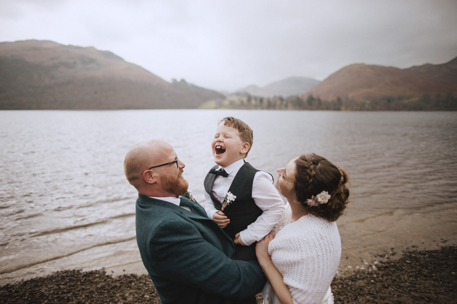 bride, groom and their son laughing