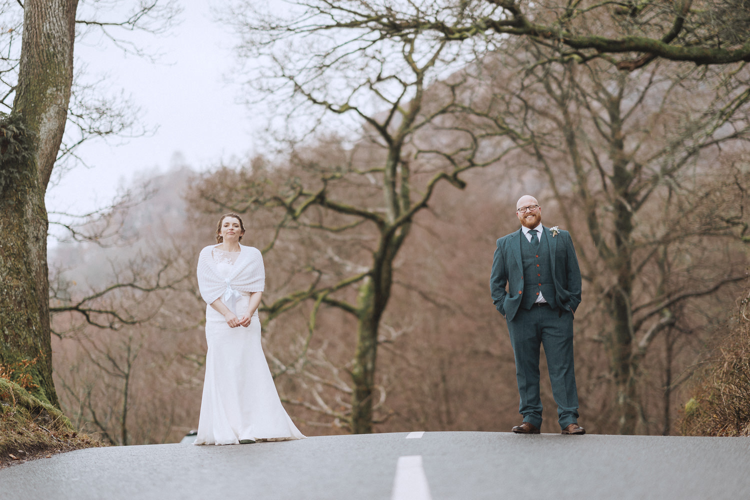 bride and groom standing in the road