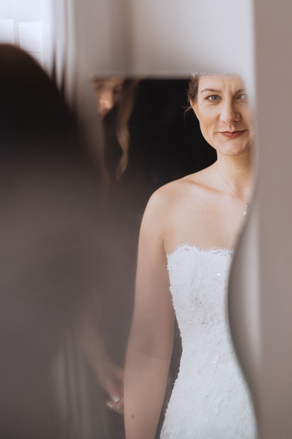 Scout Hut Wedding from Fox & Bear Photography - Bride looking at herself in the mirror