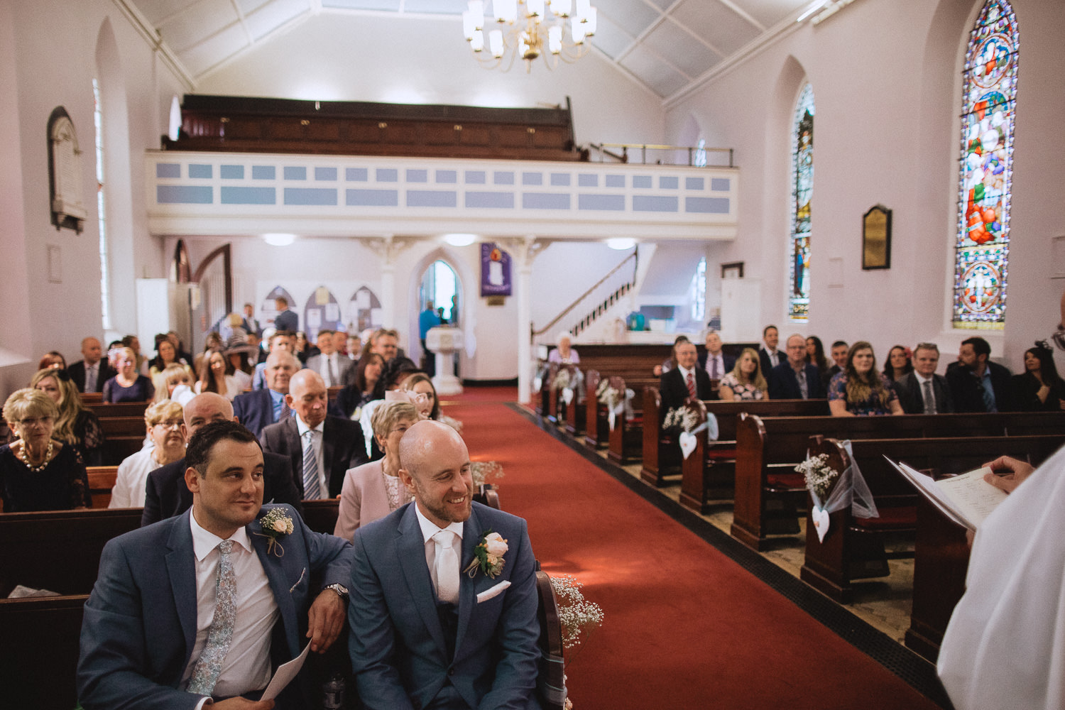 Scout Hut Wedding from Fox & Bear Photography - Groom waiting at the church for his bride