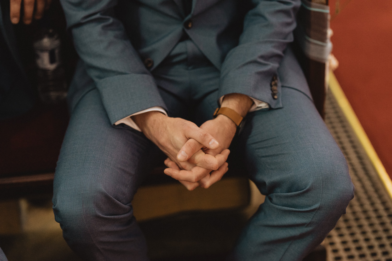 Scout Hut Wedding from Fox & Bear Photography - Groom clasping his hand waiting