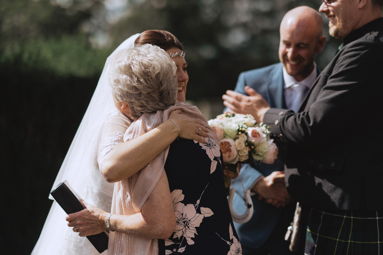 Scout Hut Wedding from Fox & Bear Photography - Bride hugging a guest after their ceremony