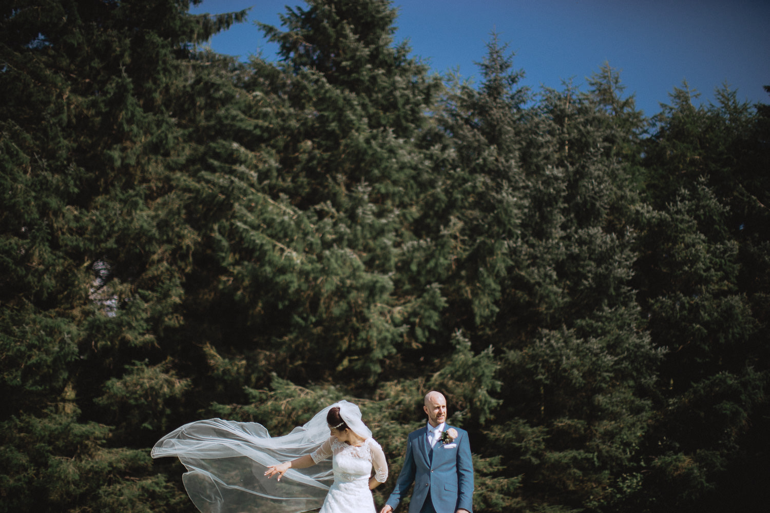 Scout Hut Wedding from Fox & Bear Photography - bride and groom in Macclesfield forest - windy day