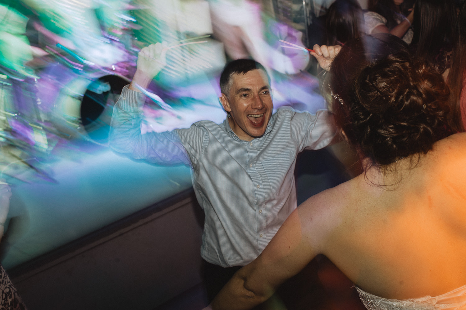 Scout Hut Wedding from Fox & Bear Photography - Dancing guest - Dragging the shutter