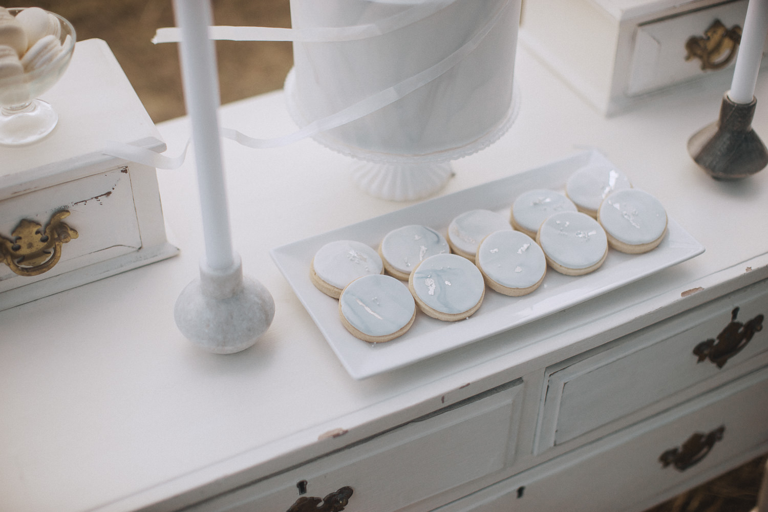 Silver cookies on a dresser by Hayley's piped dreams
