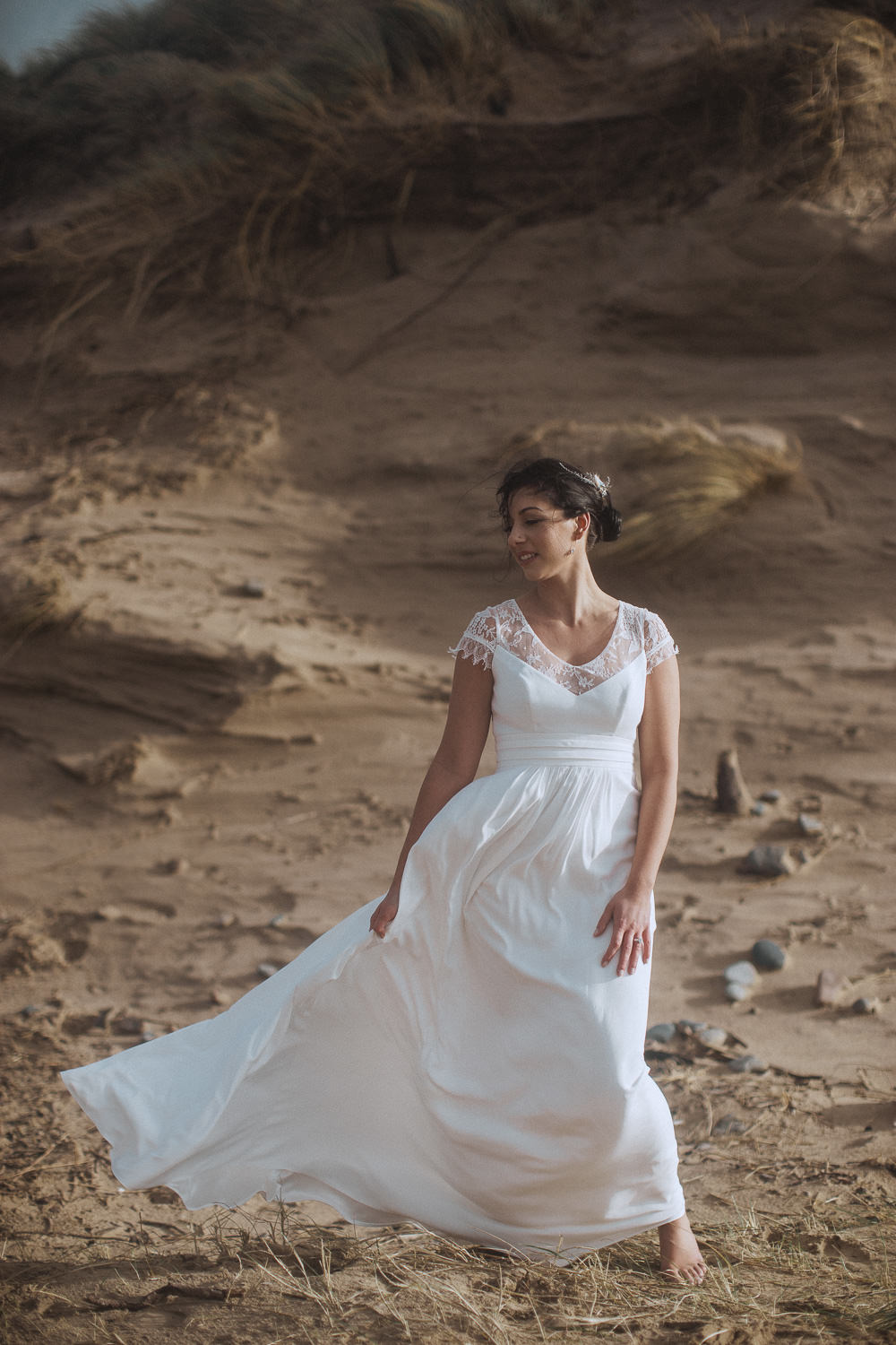 A bride in a boho gown on Newborough Beach, Anglesey