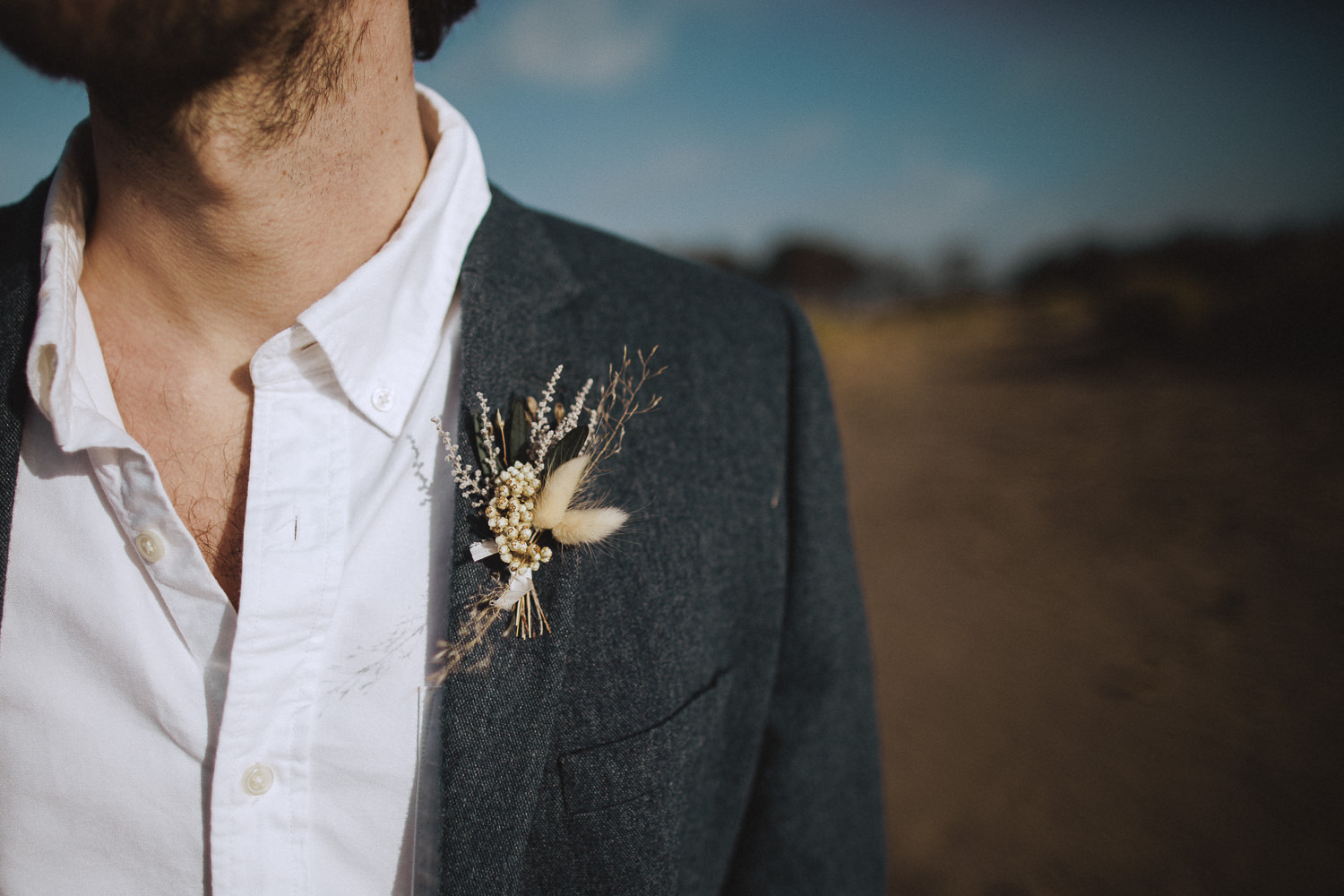Close up of a dried flower boutonnière at newborough beach, anglesey