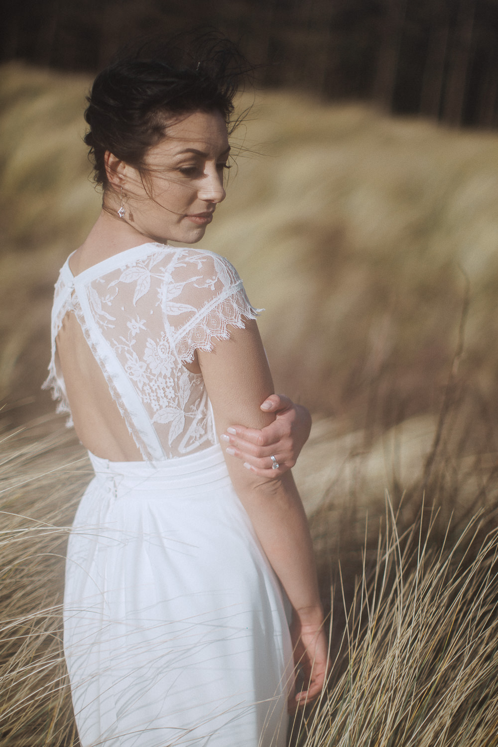 Bride in a rembo gown during an elopement at Newborough Beach, Anglesey, Wales