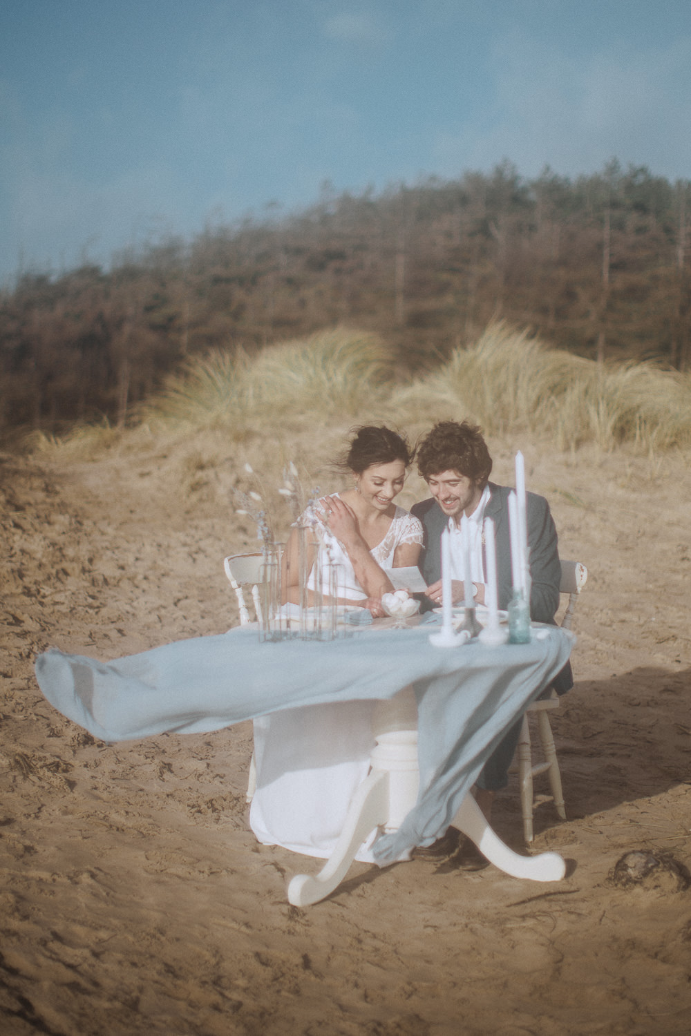 Bride and Groom looking at their menu Newborough Beach, Anglesey, Wales