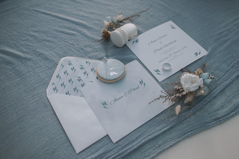 Flatlay for a minimal winter beach wedding