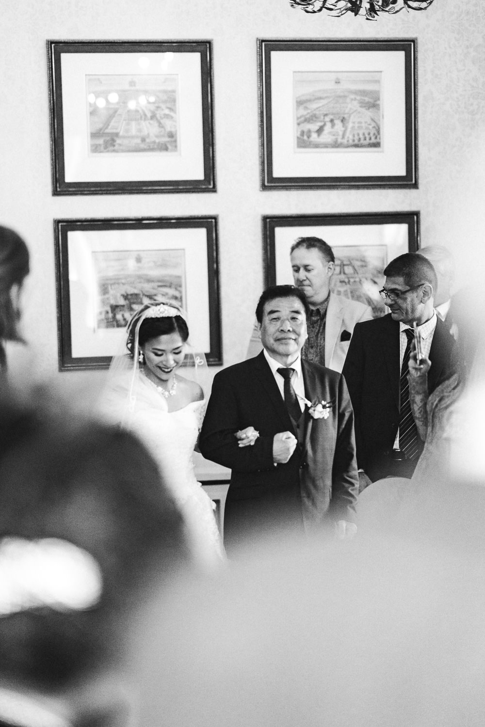 A bride and her father walking down the isle at Inglewood Manor, Cheshire