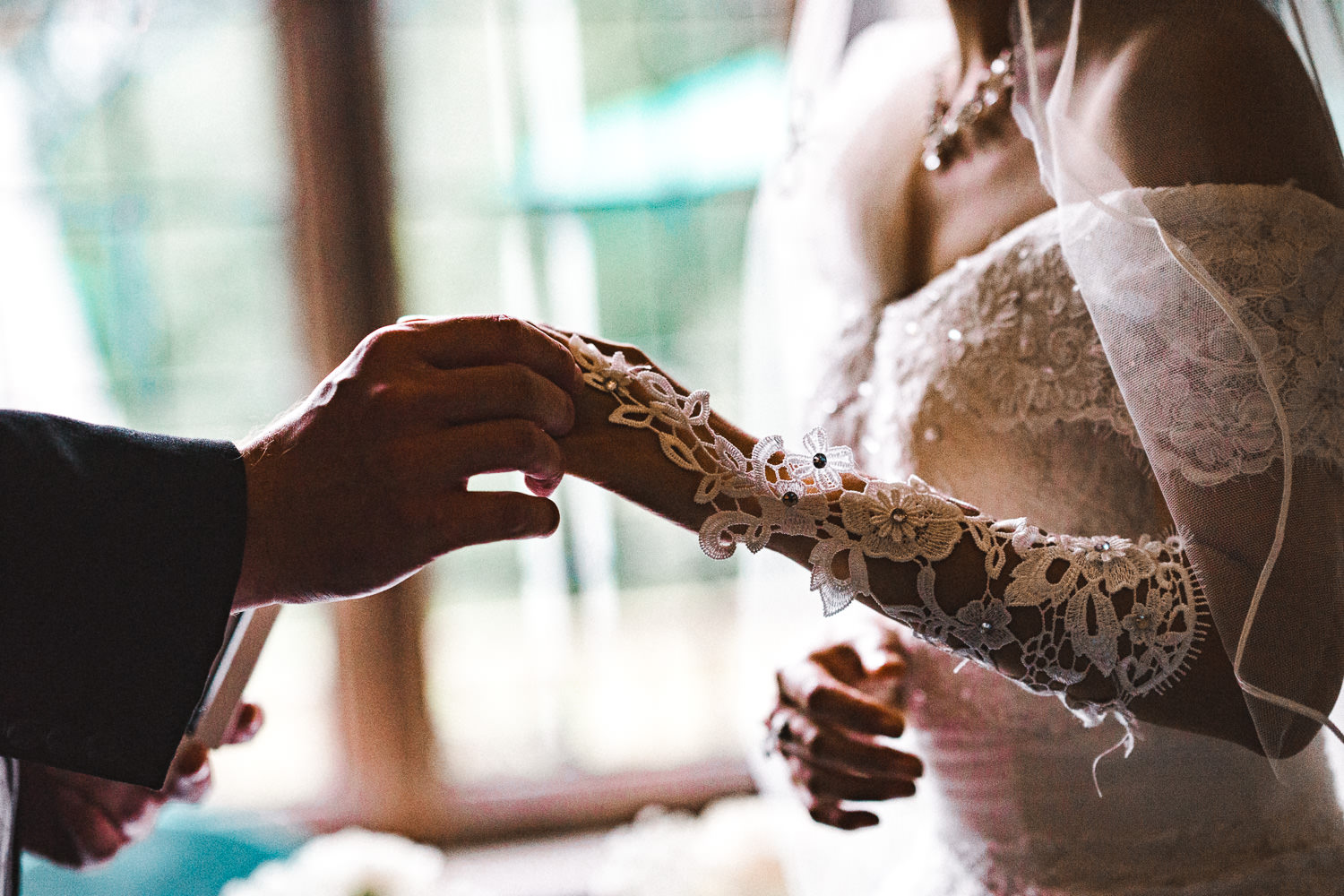 Close up of the bride and groom holding hands during their ceremony at Inglewood Manor, Cheshire