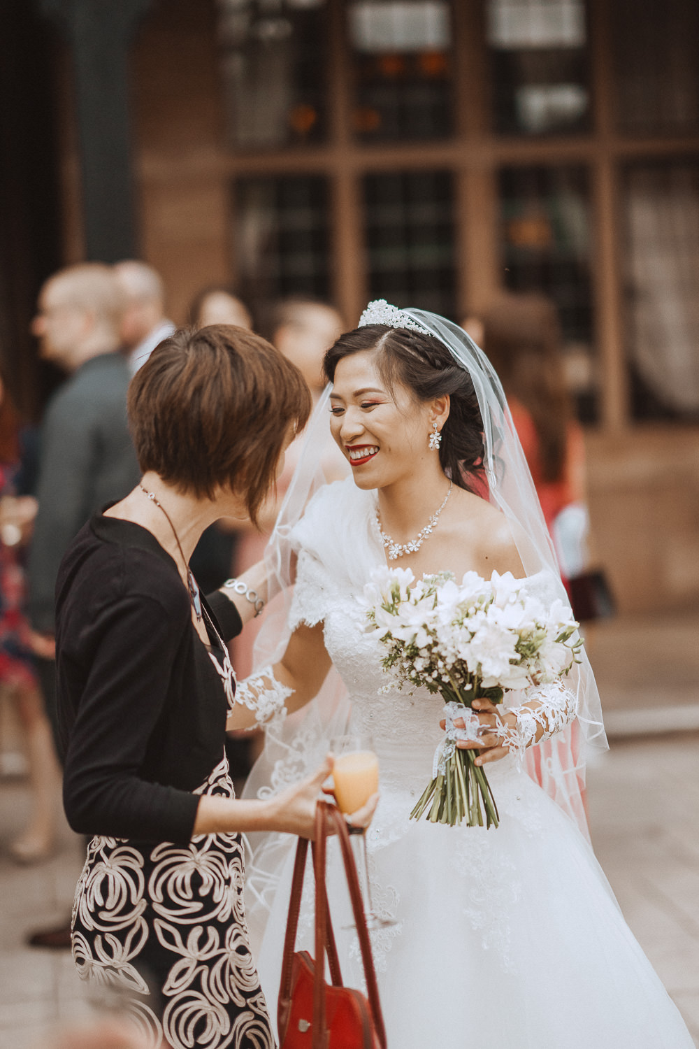 Bride chatting to her guests at Inglewood Manor, Cheshire