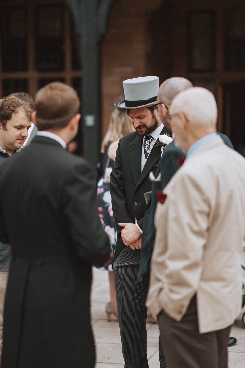 Groom chatting to guests at at Inglewood Manor, Cheshire