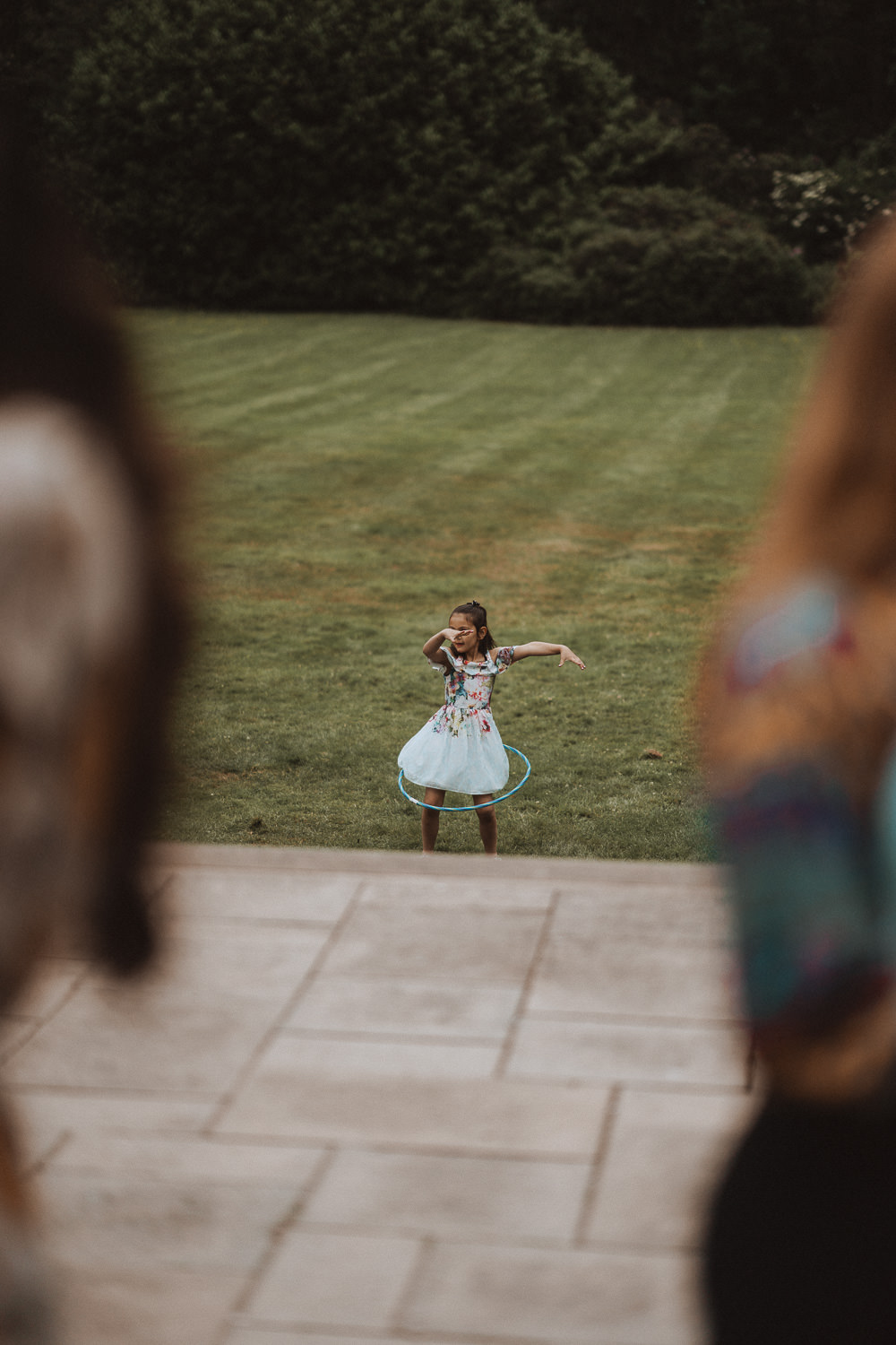 Little girl playing with a hula hoop at Inglewood Manor, Cheshire