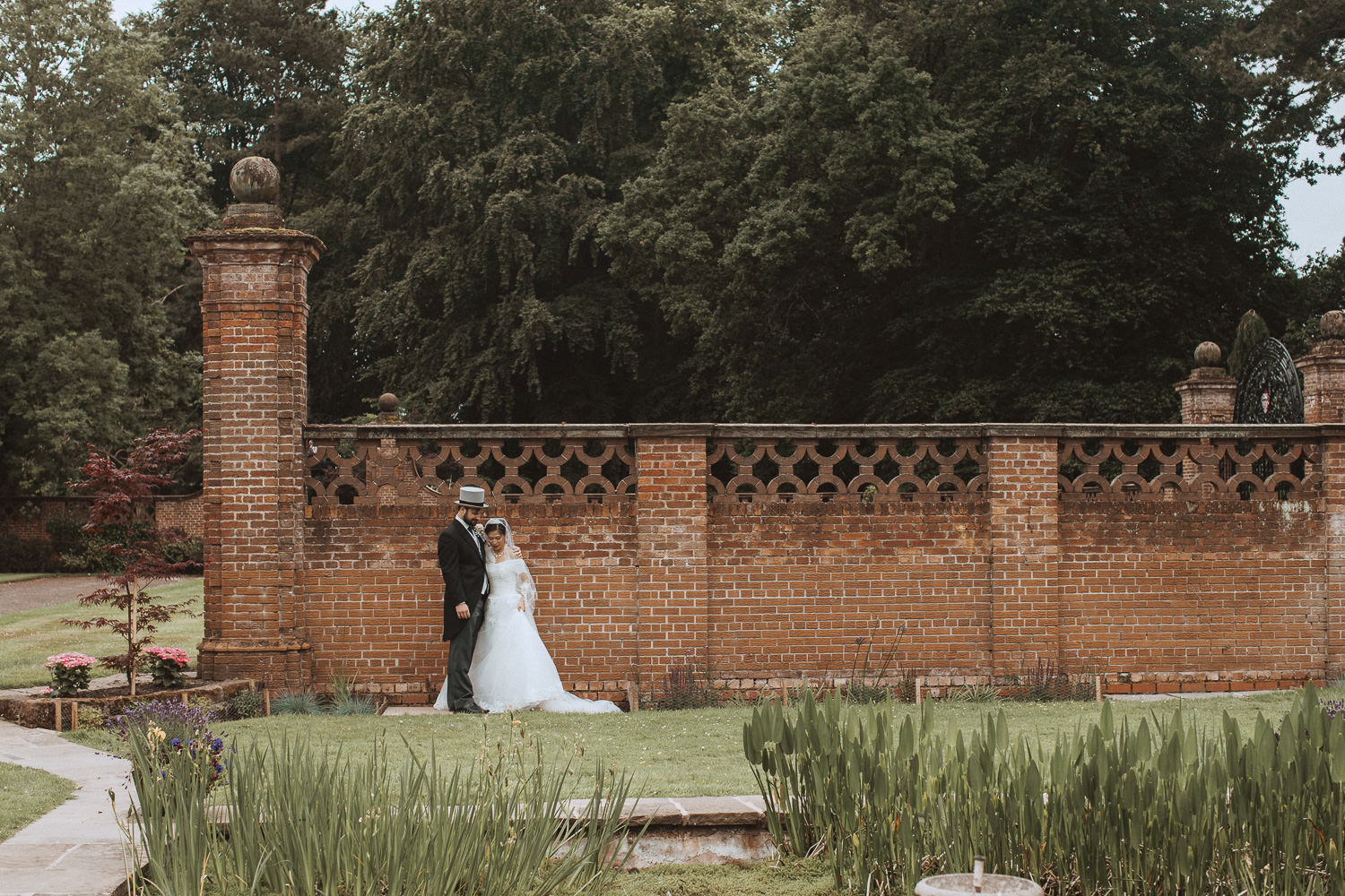 Bride and groom against a wall at Inglewood Manor, Cheshire