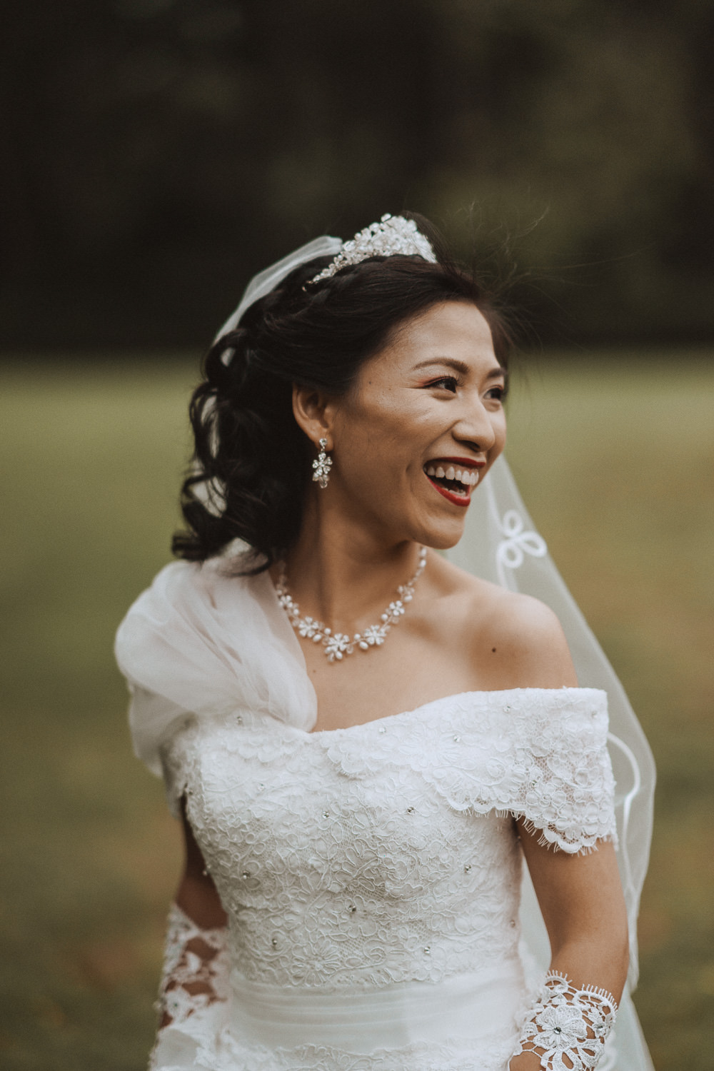 Bride laughing at Inglewood Manor, Cheshire
