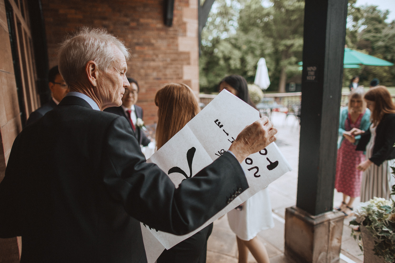 Guests being given hand painted Chinese calligraphy at Inglewood Manor, Cheshire