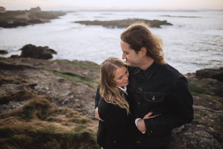 Couple on rocky beachside